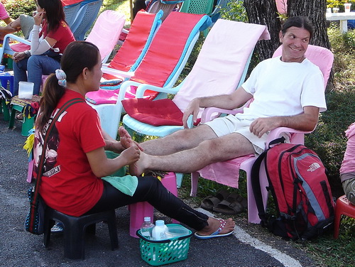 foot massage in the city park500px
