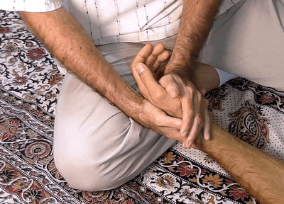 hand massage sandwich squeeze technique