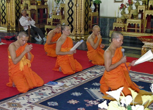 Monks chanting in a temple in Thailand
