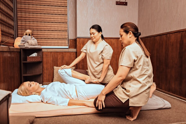 thai massage therapists with client