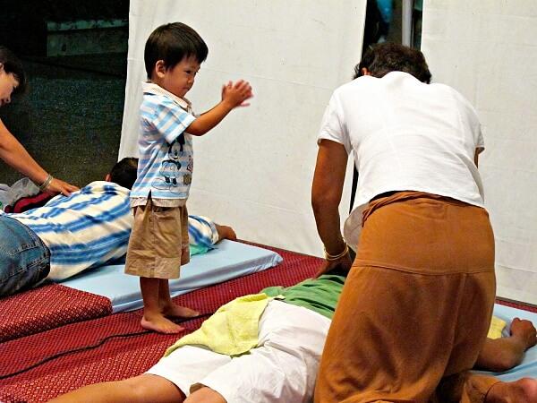 watching daddy getting a thai massage