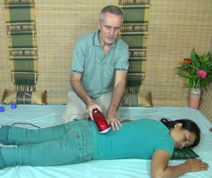 image of back massage with massage hammer