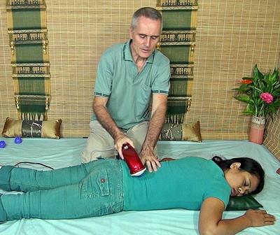 back massage with massage hammer