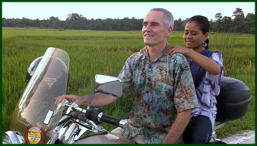 author receiving massage on a motorbike