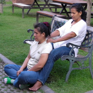 Thai massage therapists massaging each other