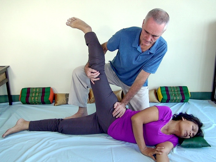 Thai Massage hip stretch side position