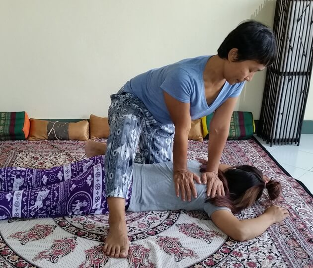 Thai Massage shoulder compression