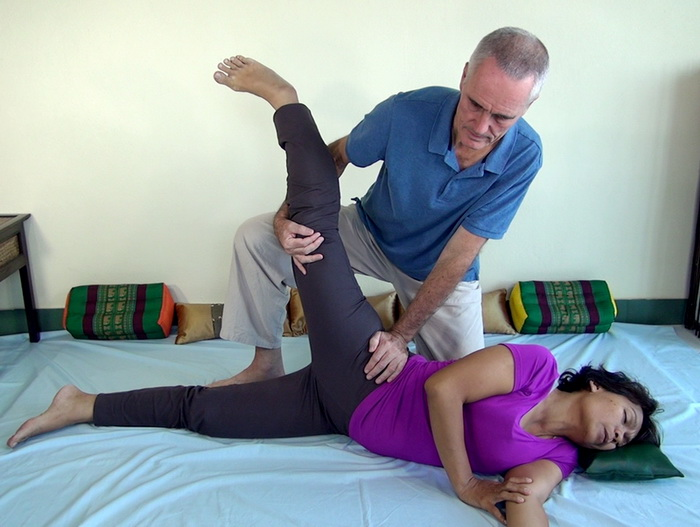 Thai Massage hip stretch in the side position