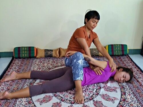 thai-massage shoulder stretch